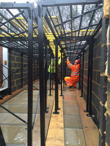 Employee Constructing Rhino Deck For Platforming Uses